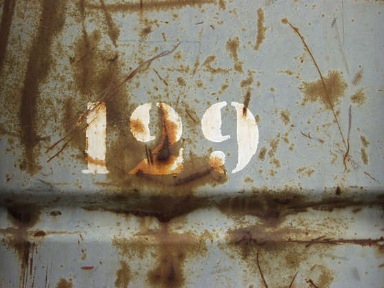 sign numbers 1 2 9 painted rust