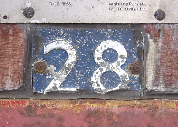 sign metal number 2 8 worn damaged dirty