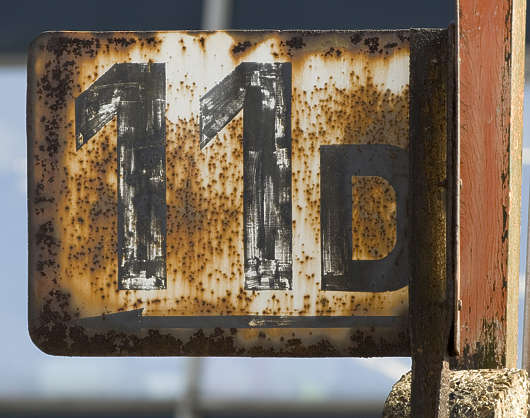 sign numbers rusted