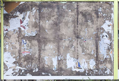 billboard weathered torn sticker poster wooden