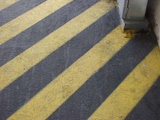 sign warning stripes black yellow tarmac paint sprayed asphalt stripe