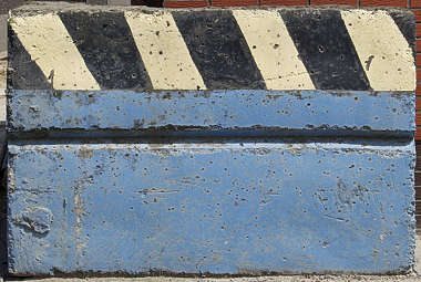 sign warning stripes black yellow faded worn concrete damaged stripe
