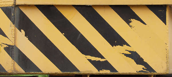 sign stripes yellow black warning worn paint damaged stripe