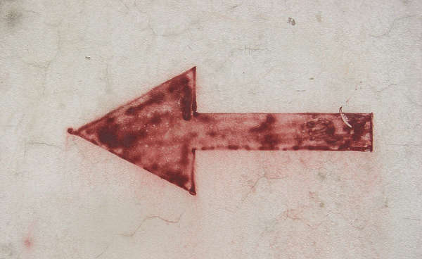 sign arrow painted sprayed concrete faded
