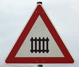 sign train crossing fence