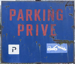 parking sign old rusted