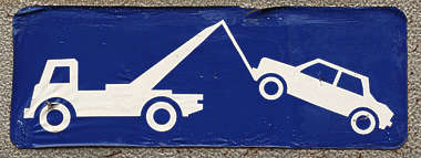 sign tow truck car traffic