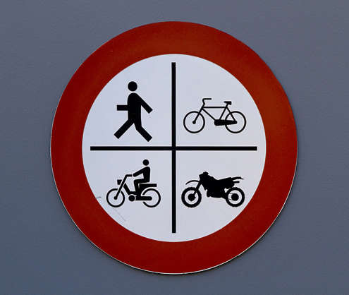 sign traffic pedestrian bicycle motorcycle moped