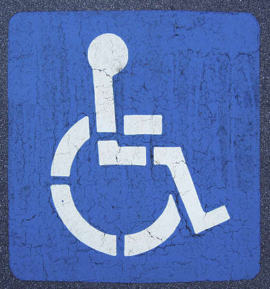 traffic sign wheelchair asphalt street tarmac