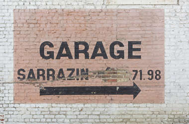 brick small modern painted garage sign
