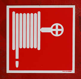 sign warning fire hose
