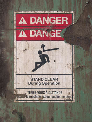sign warning danger stand clear instruction sticker damaged