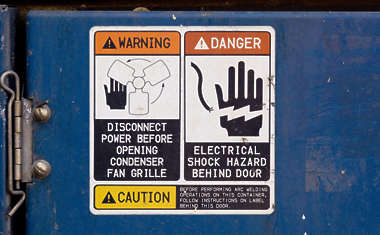 sticker warning danger shock electrical fan crush container