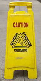 sign english new york NY US caution wet slippery floor barrier wet