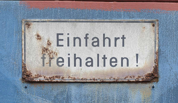 sign rusted metal german