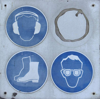 sign glue warning safety head ear protection faded dirty closeup boots goggles glass eye