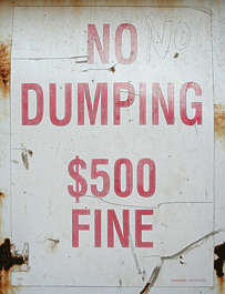 sign fine dumping trash warning