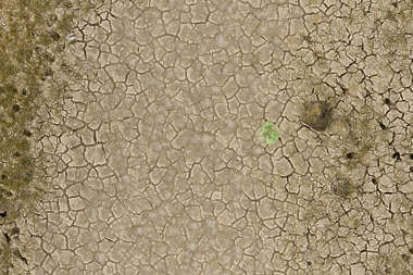 aerial sand cracked earth dry desert lake riverbed cracks