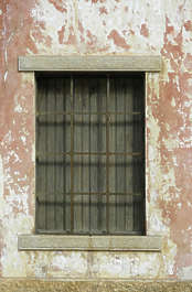 window house old bars barred plaster salmon