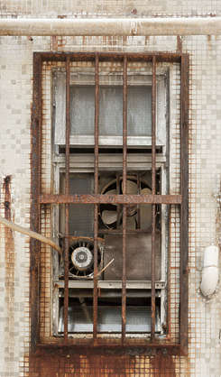 window windows hong kong barred bars rusted old fan vent