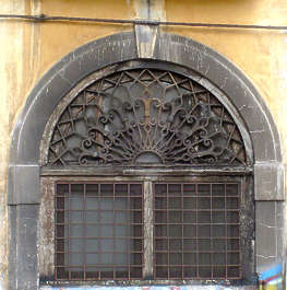 window barred old dirty arch ornate