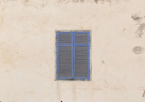 north africa arabia arabian morocco window shutters double painted weathered old