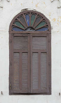 window ornate moorish shutters morocco