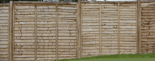wood planks bare fence UK