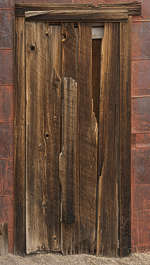 USA Bodie ghosttown ghost town old western goldrush desert arid door barred up wooden makeshift bodie_003