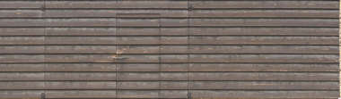 wood planks overlapping bare barn old plank siding