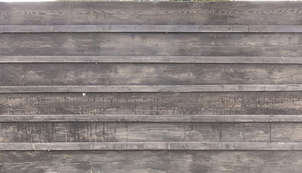wood planks overlapping overlapping bare old siding