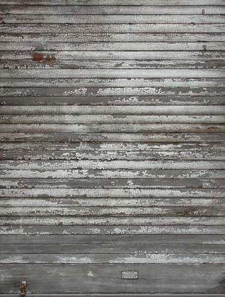 planks rollup door old paint cracked weathered siding