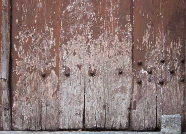 wood planks dirty old paint worn bare nails closeup siding