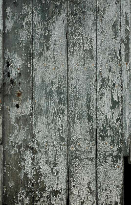 wood planks old paint worn weathered siding
